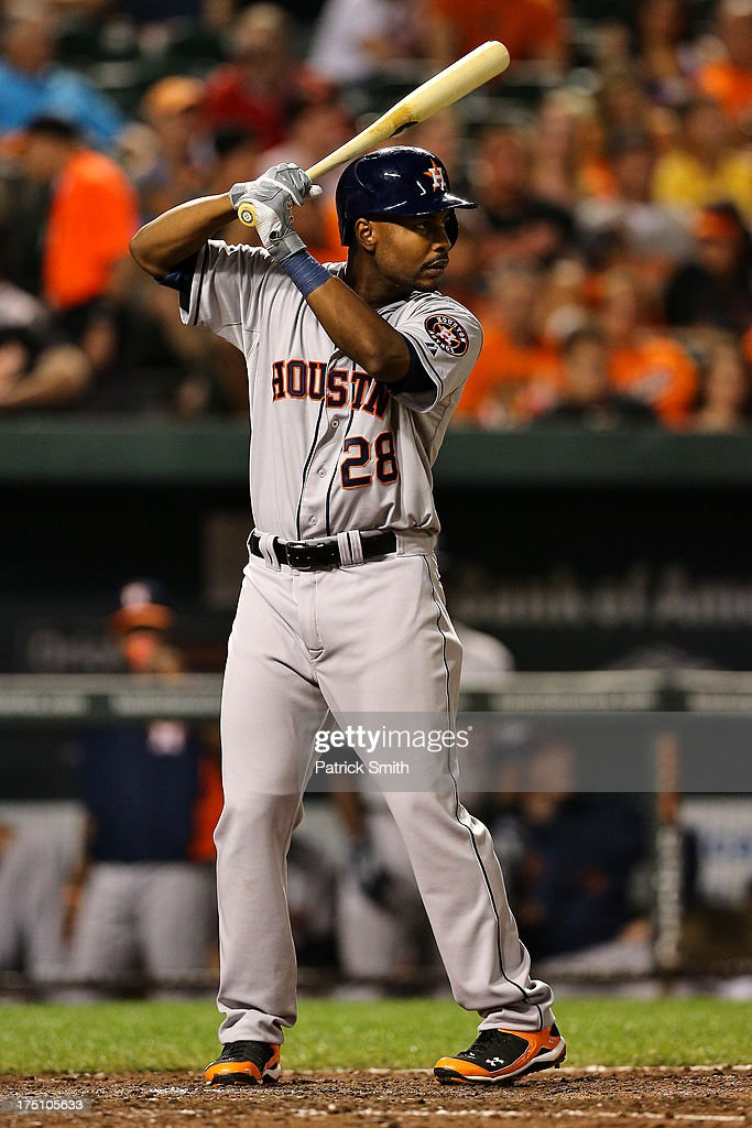 L.J. Hoes #28 of the Houston Astros hits in the sixth inning against the Baltimore Orioles at Oriole Park at Camden Yards on July 31, 2013 in Baltimore, Maryland. The Houston Astros won, 11-0.
