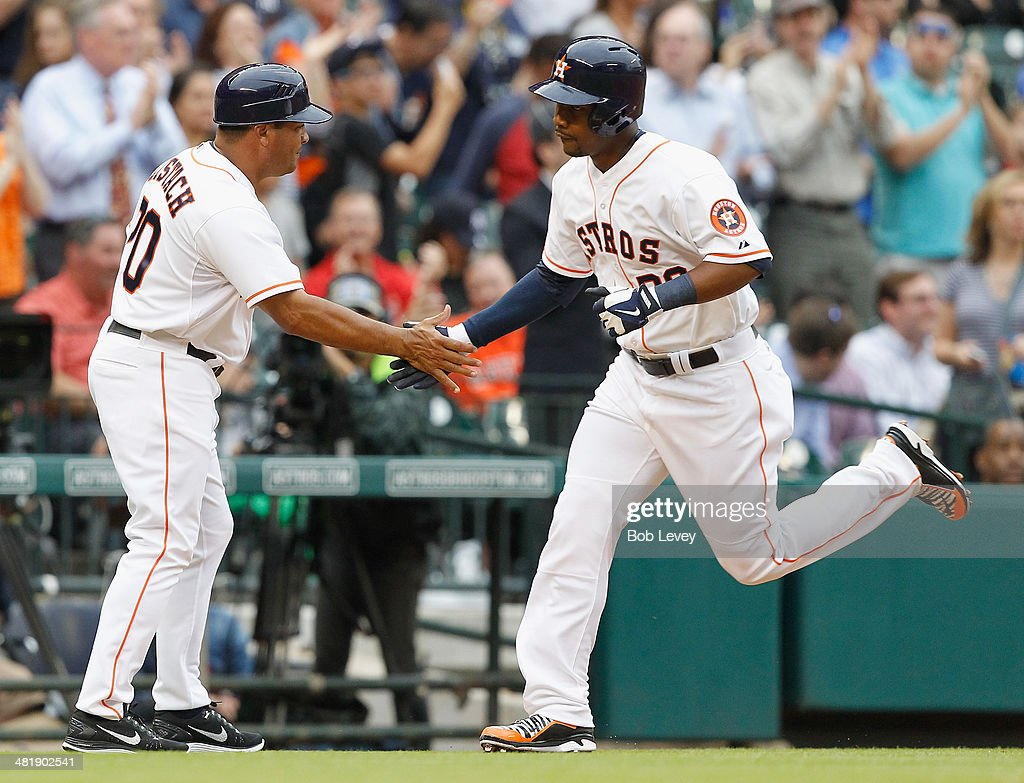 L.J. Hoes #28 of the Houston Astros receives a congratulations from third base coach Pat Listach after hitting a home run in the second inning against the New York Yankees at Minute Maid Park on April 1, 2014 in Houston, Texas.