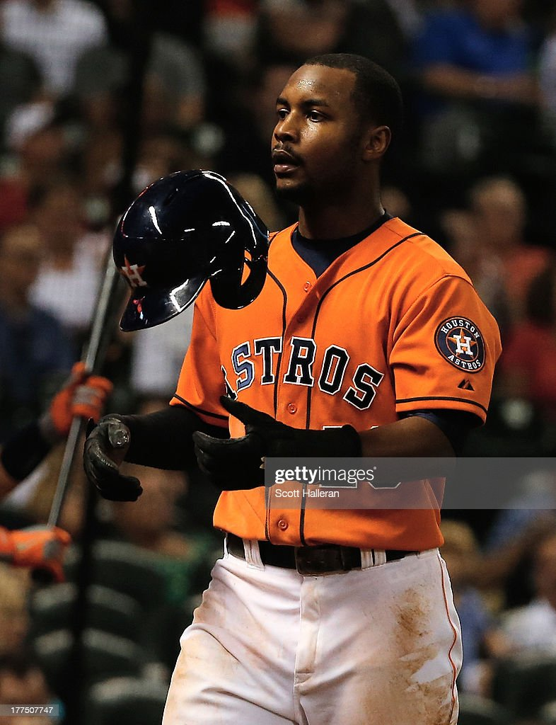 L.J. Hoes #28 of the Houston Astros walks to the dugout after scoring a run in the third inning against the Toronto Blue Jays at Minute Maid Park on August 23, 2013 in Houston, Texas.