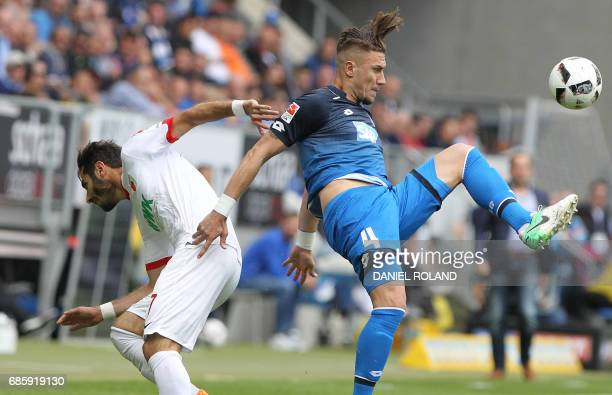 Hoffenheim's Bosnian defender Ermin Bicakcic and Augsburg's Turkish midfielder Halil Altintop vie for the ball during the German first division...