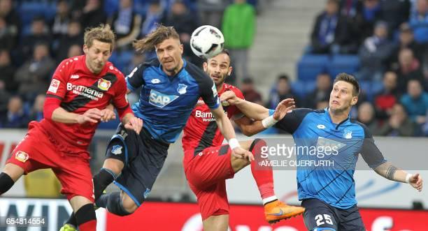 Hoffenheim's Bosnian defender Ermin Bicakcic and Hoffenheim's defender Niklas Suele and Leverkusen's forward Stefan Kiessling and Leverkusen's...