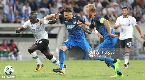 Hoffenheim's Bosnian defender Ermin Bicakcic and Hoffenheim's midfielder Kevin Vogt and Liverpool's Senegalese midfielder Sadio Mane vie for the ball...