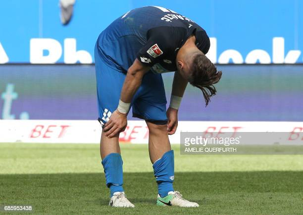 Hoffenheim's Bosnian defender Ermin Bicakcic reacts after the German first division football match between TSG Hoffenheim 1899 and FC Augsburg on May...