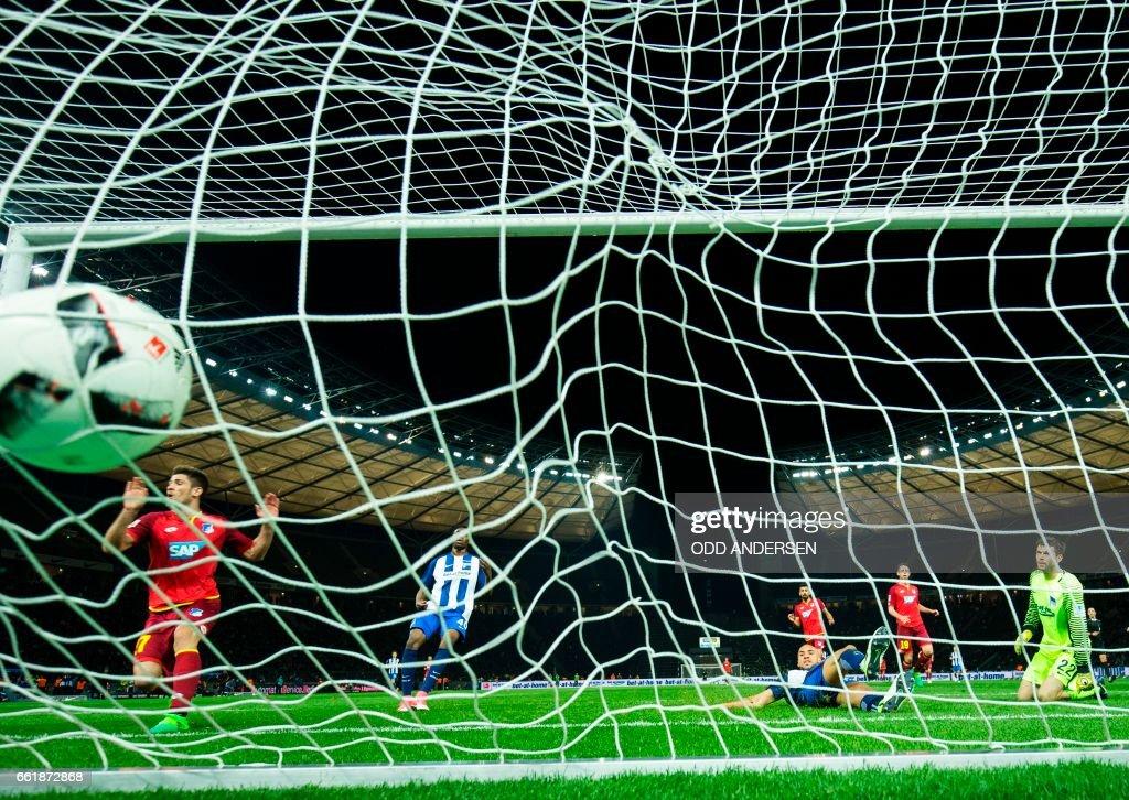 Hoffenheim´s Croatian forward Andrej Kramaric (L) scores his side's 3rd goal past Hertha Berlin's Norwegian goalkeeper Rune Jarstein (R) during the German First division Bundesliga football match Hertha Berlin v Hoffenheim at the Olympic Stadium in Berlin, on March 31, 2017. / AFP PHOTO / Odd