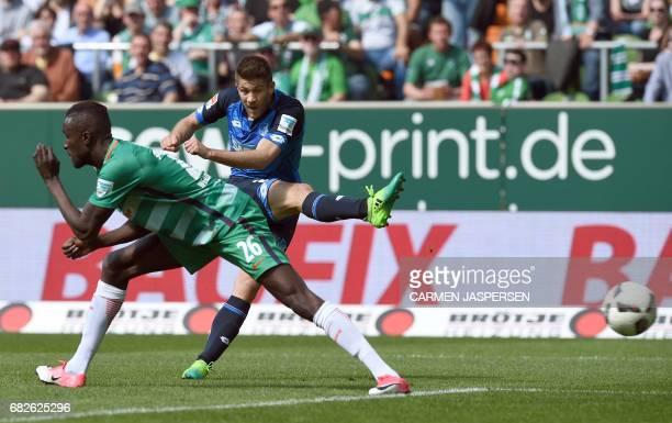 Hoffenheim's Croatian forward Andrej Kramaric scores the 20 behind Bremen's Senegalese defender Lamine Sane during the German first division...