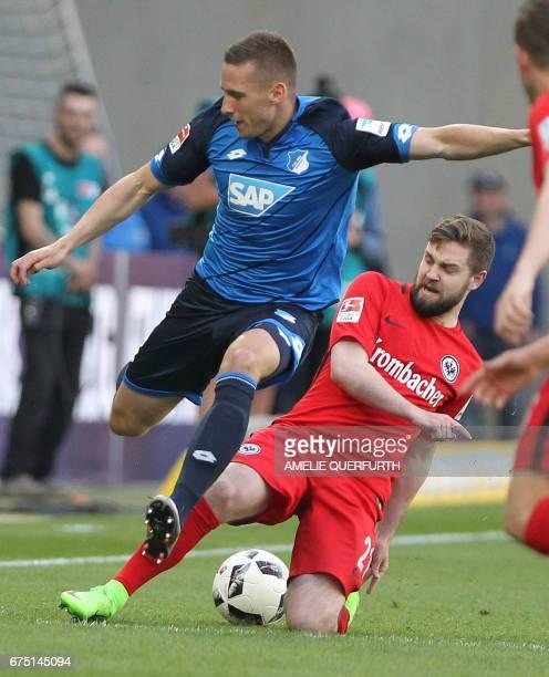Hoffenheim's Czech defender Pavel Kaderabek and Frankfurt's midfielder Marc Stendera vie for the ball during the German first division Bundesliga...