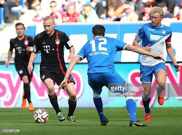 Hoffenheim's defender Andreas Beck and Hoffenheim's midfielder Tobias Strobl and Bayern Munich's midfielder Sebastian Rode vie for the ball during...