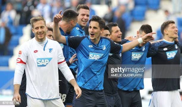 Hoffenheim's defender Benjamin Huebner celebrates the 10 after the German first division Bundesliga football match between TSG Hoffenheim and...