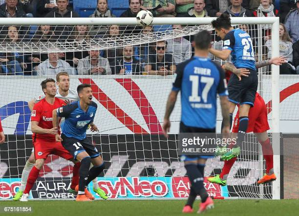 Hoffenheim's defender Benjamin Huebner scores the 10 during the German first division Bundesliga football match between TSG Hoffenheim and Eintracht...