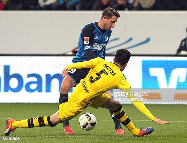 Hoffenheim's forward Mark Uth and Dortmund's Spanish defender Marc Bartra vie for the ball during the German first division Bundesliga football match...