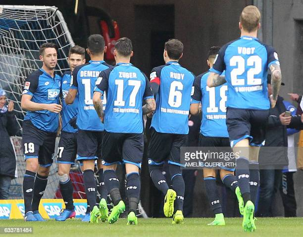 Hoffenheim's forward Mark Uth celebrate scoring the 10 goal with his teammates during the German first division Bundesliga football match TSG 1899...