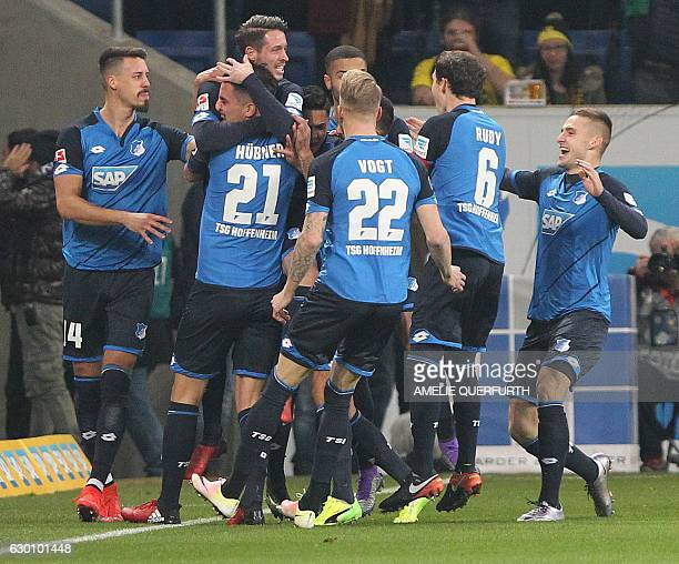 Hoffenheim's forward Mark Uth celebrate scoring with his teammates during the German first division Bundesliga football match between TSG Hoffenheim...