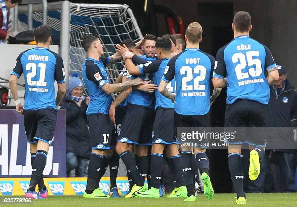 Hoffenheim's forward Mark Uth celebrates scoring the 10 goal during the German first division Bundesliga football match TSG 1899 Hoffenheim vs FSV...
