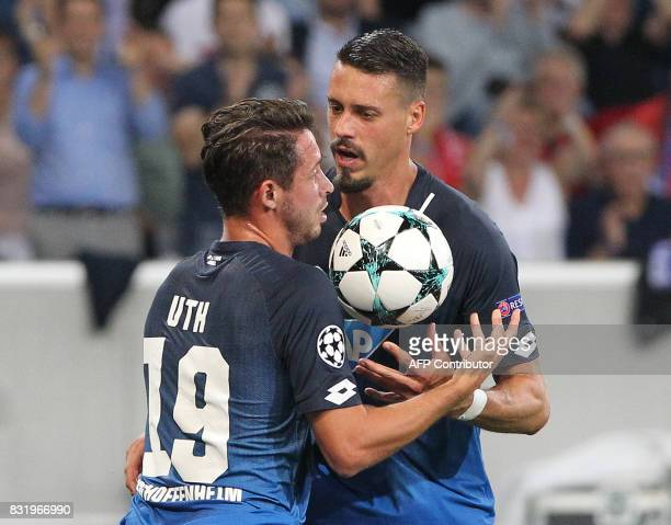 Hoffenheim's forward Mark Uth celebrates scoring the 21 during the Champions League football qualifier match TSG 1899 Hoffenheim vs Liverpool FC in...