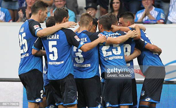Hoffenheim's forward Mark Uth celebrates scoring the 21 with his teammates during the German first division Bundesliga football match of TSG 1899...