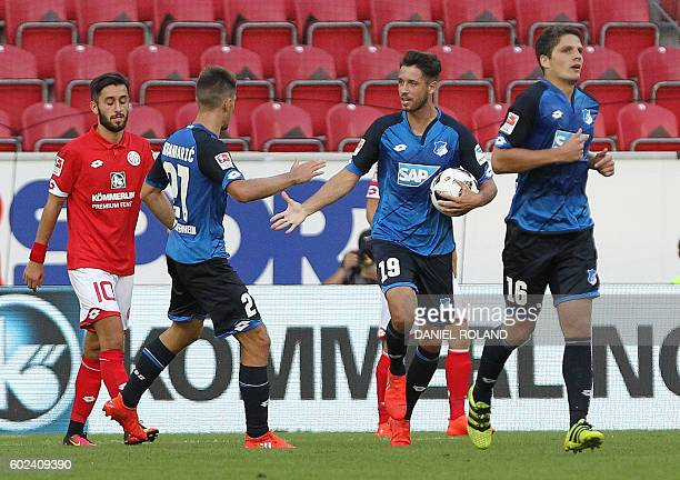 Hoffenheim's forward Mark Uth celebrates scoring the 42 during the German first division Bundesliga football match between FSV Mainz and TSG...