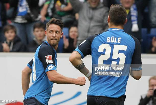 Hoffenheim's forward Mark Uth celebrates scoring the 42 during the German First division Bundesliga football match between TSG Hoffenheim and...
