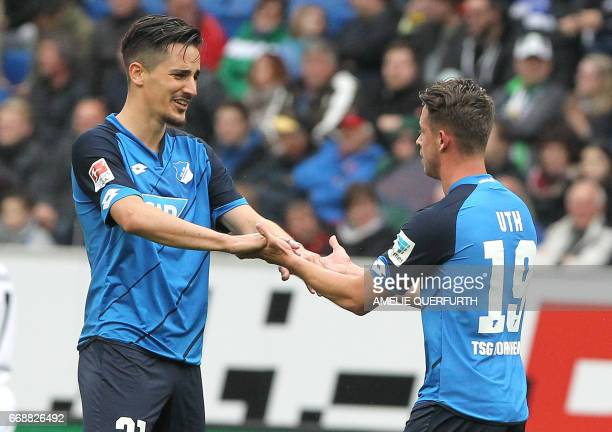 Hoffenheim's forward Mark Uth celebrates scoring the 42 during the German First division Bundesliga football match between TSG Hoffenheim and...
