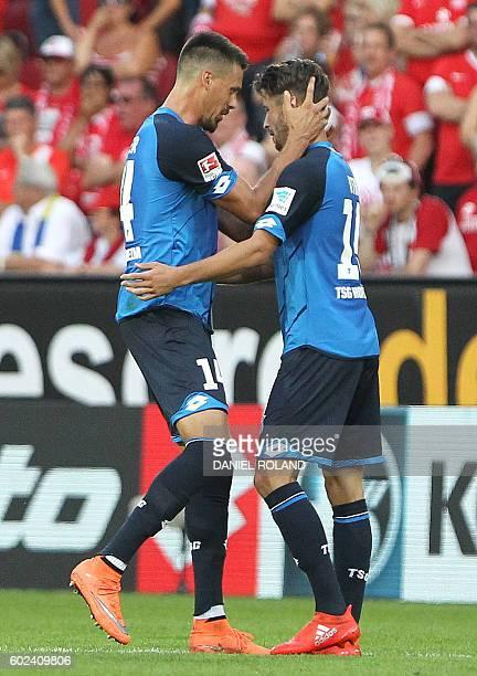 Hoffenheim's forward Mark Uth celebrates scoring the 43 with Hoffenheim's forward Sandro Wagner during the German first division Bundesliga football...