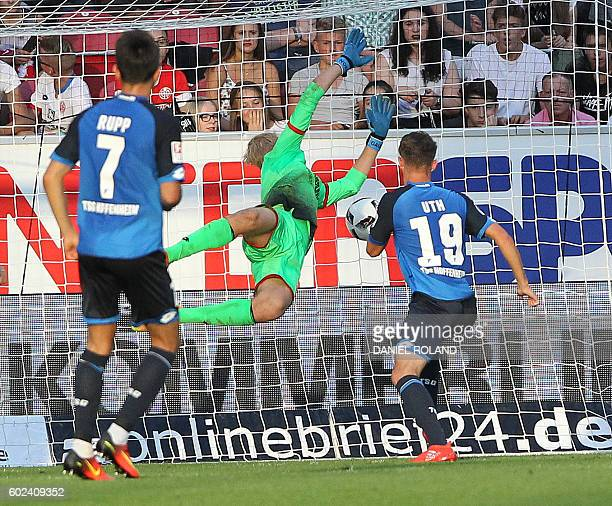 Hoffenheim's forward Mark Uth scores the 42 during the German first division Bundesliga football match between FSV Mainz and TSG Hoffenheim in the...