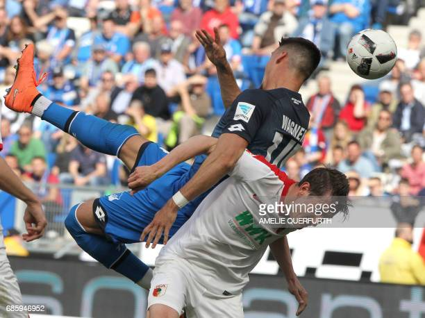 Hoffenheim's forward Sandro Wagner and Augsburg's Dutch defender Paul Verhaegh vie for the ball vie for the ball during the German first division...