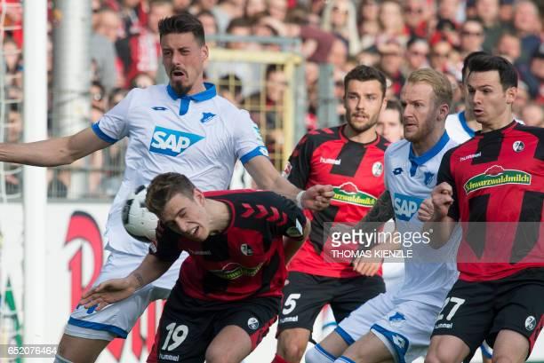Hoffenheim's forward Sandro Wagner and Freiburg's midfielder Janik Haberer vie for the ball during the German First division Bundesliga football...