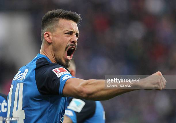 Hoffenheim's forward Sandro Wagner celebrates scoring the 11 goal during the German first division Bundesliga football match between TSG Hoffenheim...