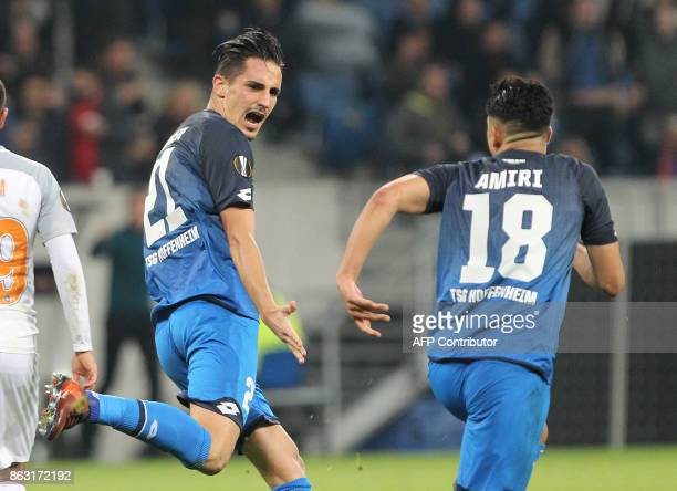 Hoffenheim's German defender Benjamin Huebner celebrates scoring the opening goal with his teammate German midfielder Nadiem Amiri during the UEFA...