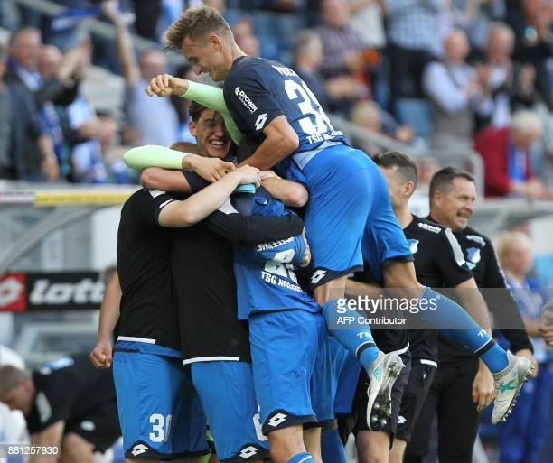 Hoffenheim's German forward Mark Uth celebrates with teammates after scoring the 21 during the German First division Bundesliga football match TSG...
