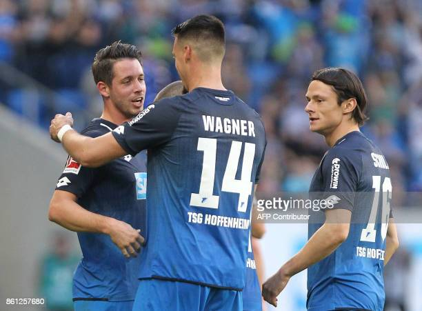 Hoffenheim's German forward Mark Uth is congratulated by Hoffenheim's German forward Sandro Wagner and Hoffenheim's German defender Nico Schulz after...