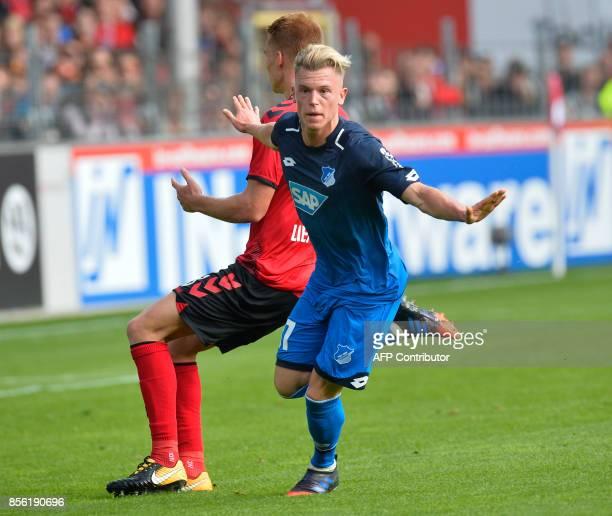 Hoffenheim's German forward Robin Hack celebrates after scoring during the German first division Bundesliga football match SC Freiburg vs TSG 1899...