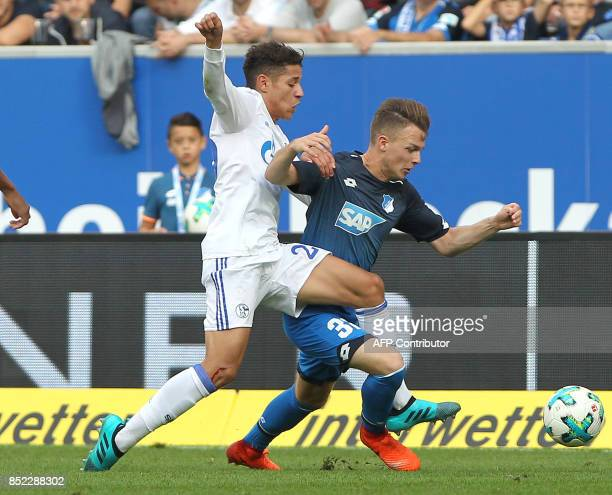 Hoffenheim's German midfielder Dennis Geiger and Schalke's Japanese defender Atsuto Uchida vie for the ball during the German first division...