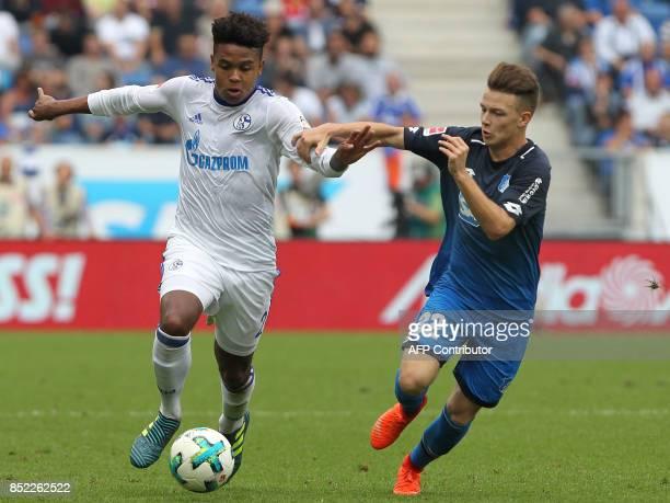 Hoffenheim's German midfielder Dennis Geiger and Schalke's US midfielder Weston McKennie vie for the ball during the German first division Bundesliga...