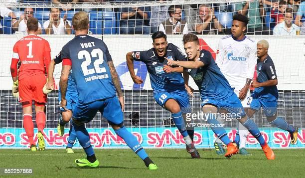 Hoffenheim's German midfielder Dennis Geiger celebrates scoring the 10 during the German first division Bundesliga football match between TSG...