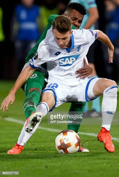 Hoffenheim's German midfielder Dennis Geiger fights for the ball against Ludogorets's Brazilian defender Cicinho during the UEFA Europa League Group...