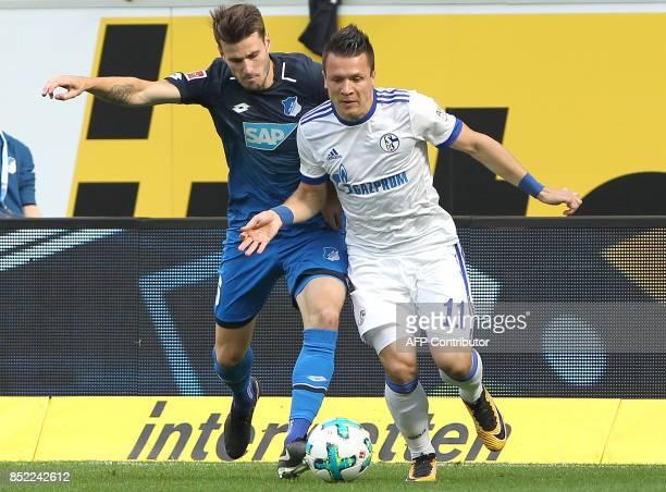 Hoffenheim's German midfielder Eugen Polanski and Schalke's Ukrainian midfielder Yevhen Konoplyanka vie for the ball during the German first division...