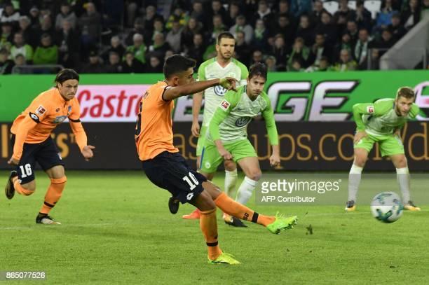 Hoffenheim's German midfielder Kerem Demirbay kicks the ball to score a penalty during the German First division Bundesliga football match TSG 1899...