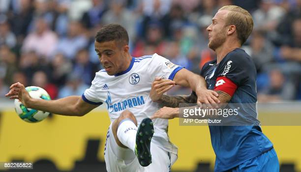 Hoffenheim's German midfielder Kevin Vogt and Schalke's Argentinian forward Franco di Santo vie for the ball during the German first division...