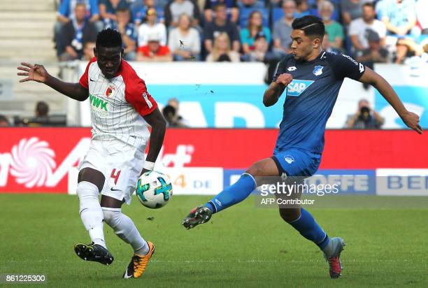 Hoffenheim's German midfielder Nadiem Amiri and Augsburg's Ghanaian defender Daniel Opare vie for the ball during the German First division...