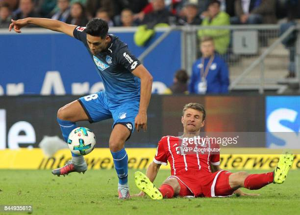 Hoffenheim's German midfielder Nadiem Amiri and Bayern Munich's forward Thomas Mueller vie during German first division Bundesliga football match...