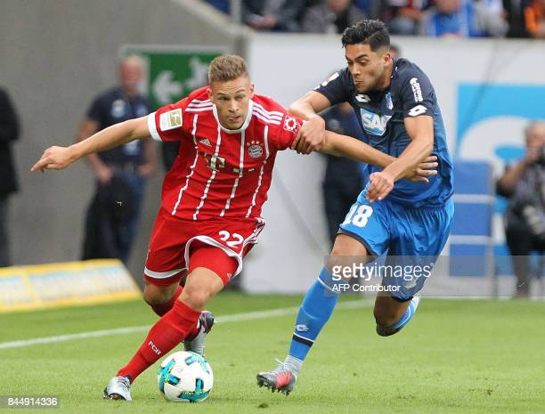Hoffenheim's German midfielder Nadiem Amiri and Bayern Munich's midfielder Joshua Kimmich vie for the ball during German first division Bundesliga...