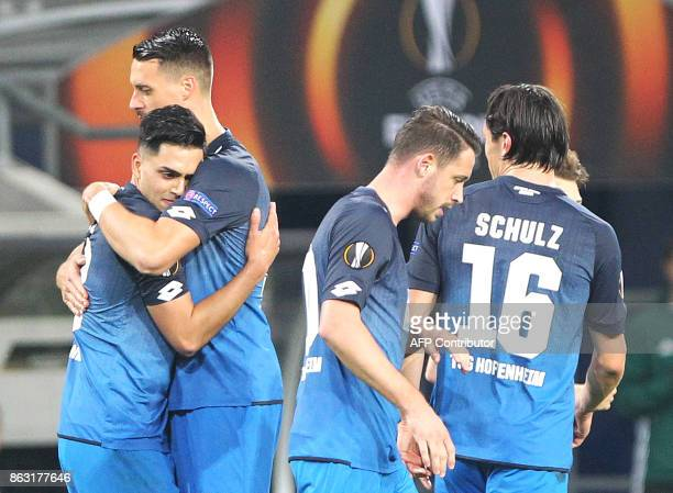 Hoffenheim's German midfielder Nadiem Amiri celebrates scoring the 20 goal with his teammates during the UEFA Europa League group C fotball match TSG...