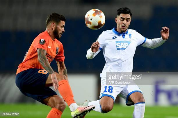 Hoffenheim's German midfielder Nadiem Amiri vies for the ball with Basaksehir's Brazilian defender Junior Caicara during the UEFA Europa League...