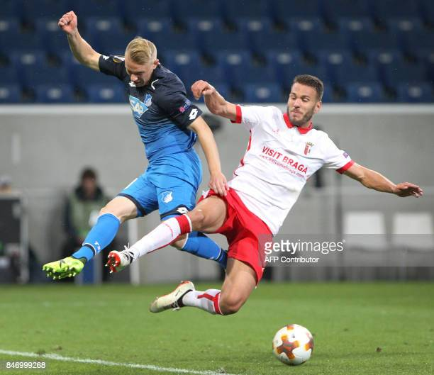 Hoffenheim's German midfielder Philipp Ochs and Sporting Braga's defender from Portugal Nuno Sequeira vie for the ball during the UEFA Europa League...