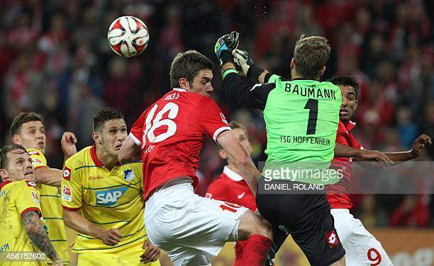Hoffenheim's goalkeeper Oliver Baumann and Mainz' defender Stefan Bell vie for the ball during the German first division Bundesliga football match 1...