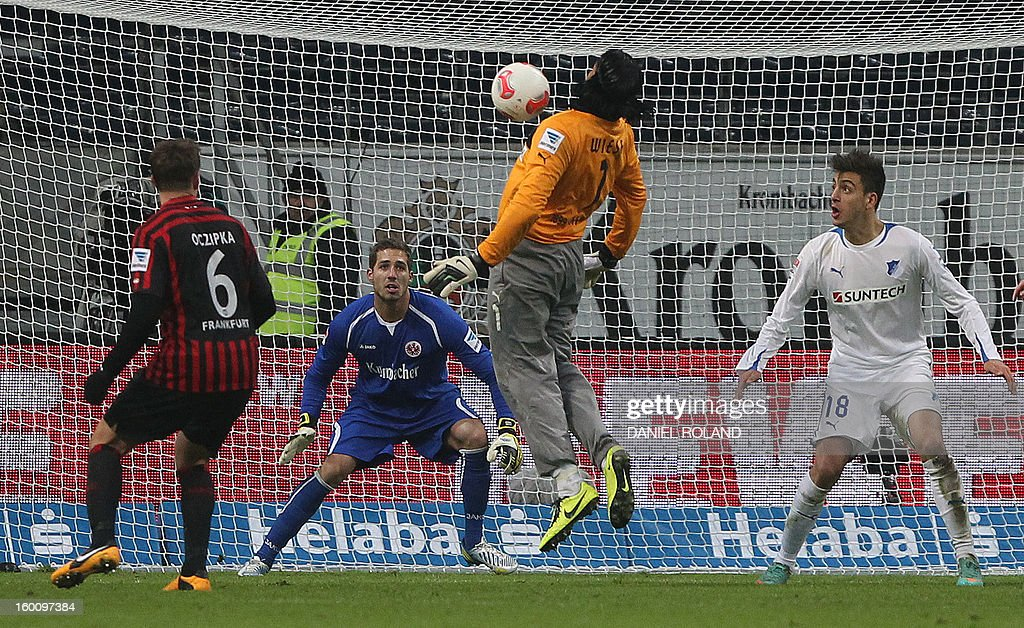 Hoffenheim's goalkeeper Tim Wiese (2nd R) tries to bring the ball inside Frankfurt's penalty area during the German first division Bundesliga football match Eintracht Frankfurt vs. TSG 1899 Hoffenheim in Frankfurt am Main, western Germany, on January 26, 2013. Frankfurt won the match 2-1. AFP PHOTO / DANIEL ROLAND