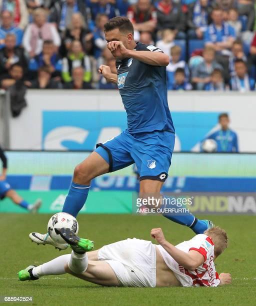 Hoffenheim's Hungarian forward Adam Szalai and Augsburg's Austrian defender Martin Hinteregger vie for the ball during the German first division...