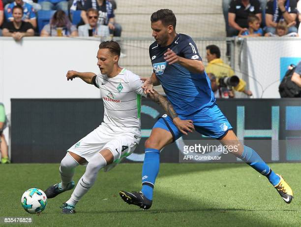 Hoffenheim's Hungarian forward Adam Szalai and Bremen's defender Robert Bauer vie for the ball during the German First division Bundesliga football...