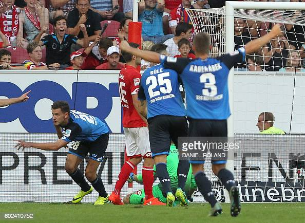 Hoffenheim's Hungarian forward Adam Szalai celebartes after scoring the 44 during the German first division Bundesliga football match between FSV...