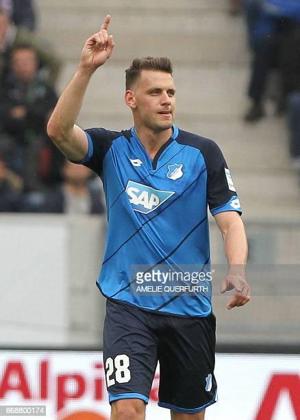 Hoffenheim's Hungarian forward Adam Szalai celebrates scoring the 20 during the German First division Bundesliga football match between TSG...